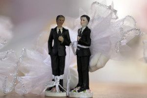 Picture taken on October 12, 2012 in Paris shows to male figurines in wedding dress. France on October 10, 2012 named October 31 as the date when a draft law authorising gay marriage will be approved by government ministers, amid mounting opposition to the proposed legislation.AFP PHOTO KENZO TRIBOUILLARD